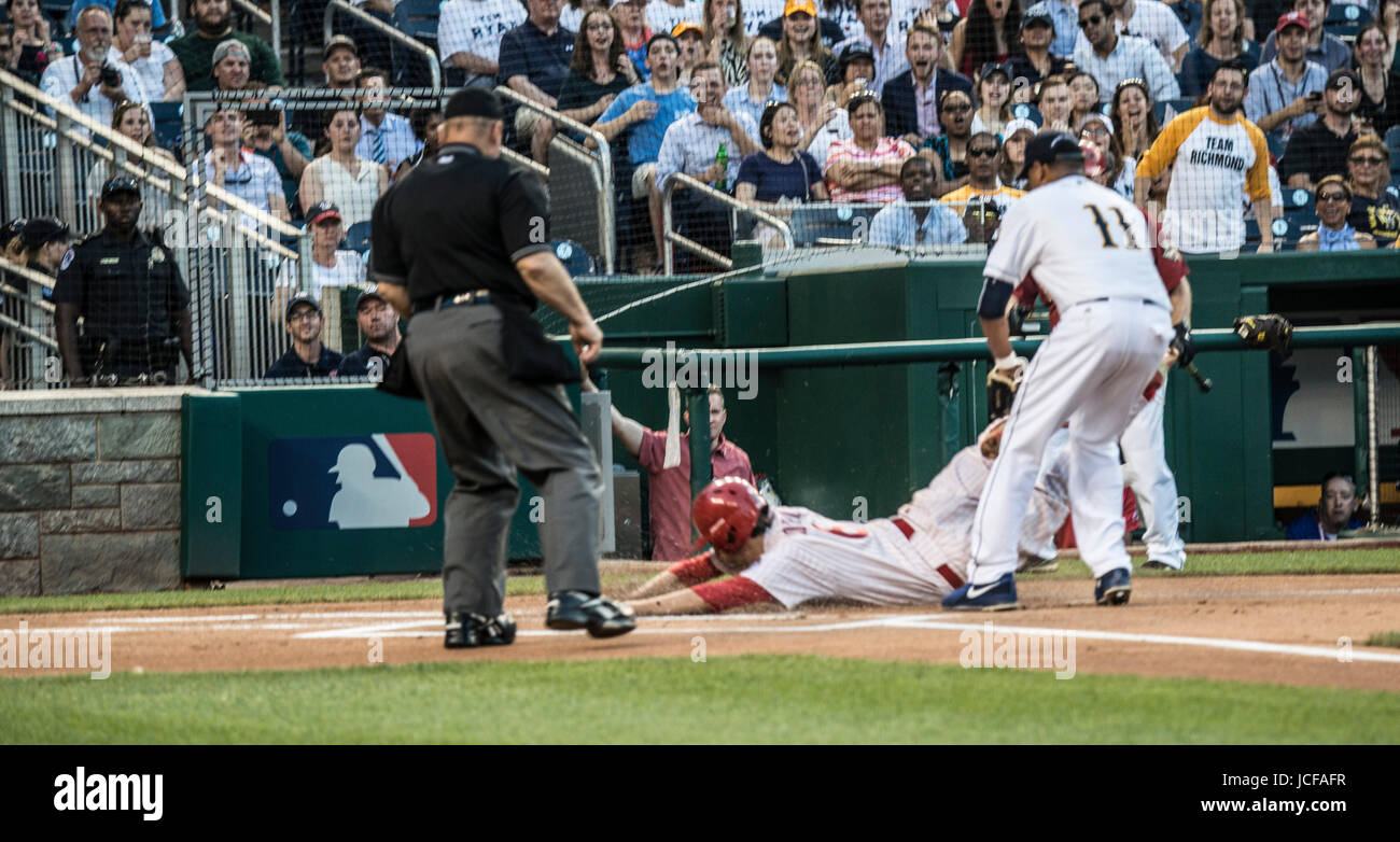 Since 1909, Members, both Democrat and Republican of the US House of Representatives and the US Senate have played in the annual Congressional Baseball game, with the money raised from ticket sales, donated to local charities.. This year, both teams played to honor House Majority Whip, Steve Scalise, R-LA who was shot during a practice session. Stock Photo