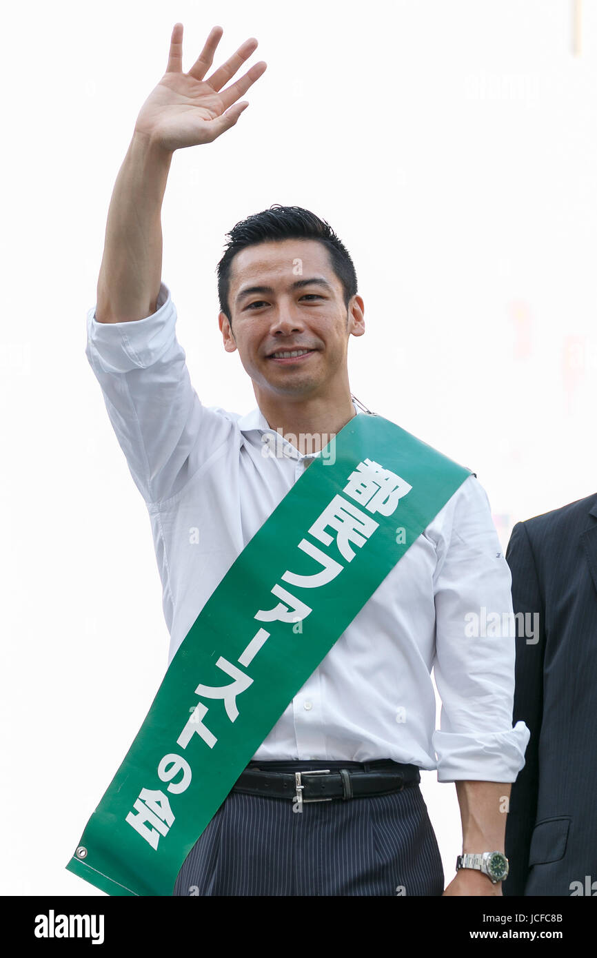 Tokyo, Japan. 16th June, 2017. Candidate Zenko Kurishita, waves to supporters during a campaign event for Tokyo's - Stock Image