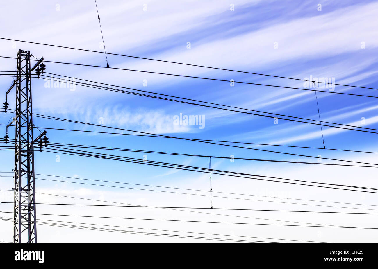 Black wire on blue sky background at day - Stock Image