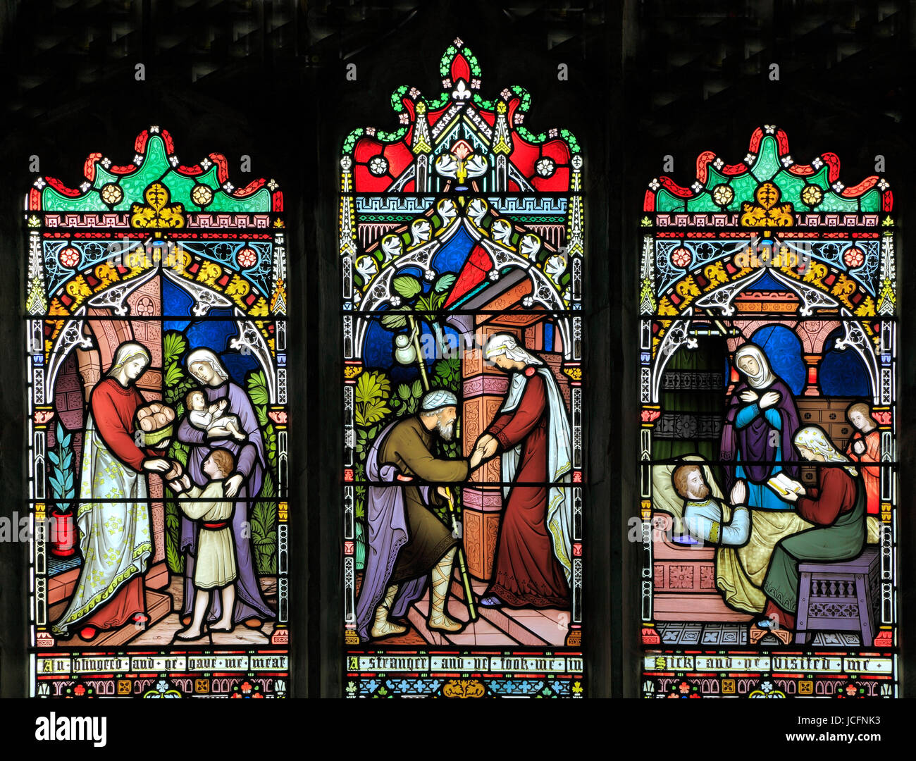 Corporal Acts of Mercy window, stained glass by Frederick Preedy, 1868, feeding the hungry, sheltering the homeless, - Stock Image