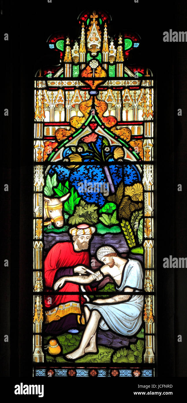 Parable of The Good Samaritan, stained glass window by Frederick Preedy, 1865, the Samaritan binds traveller's - Stock Image