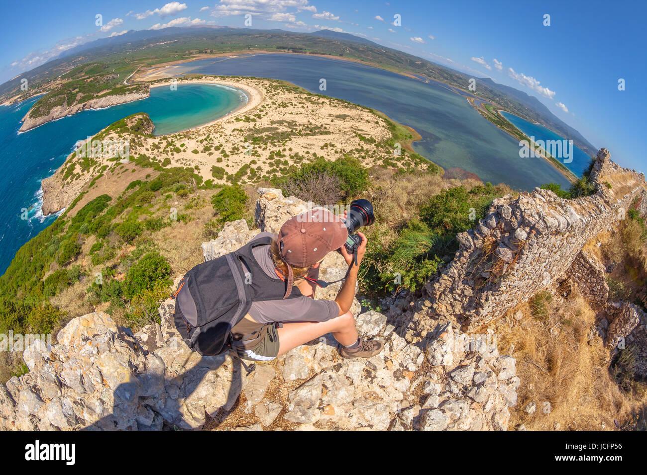 Hiker woman photographer - Stock Image