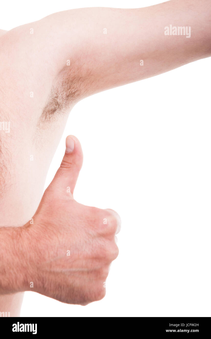 Clean underarm or armpit concept with like gesture with hairy not sweaty man under arm - Stock Image