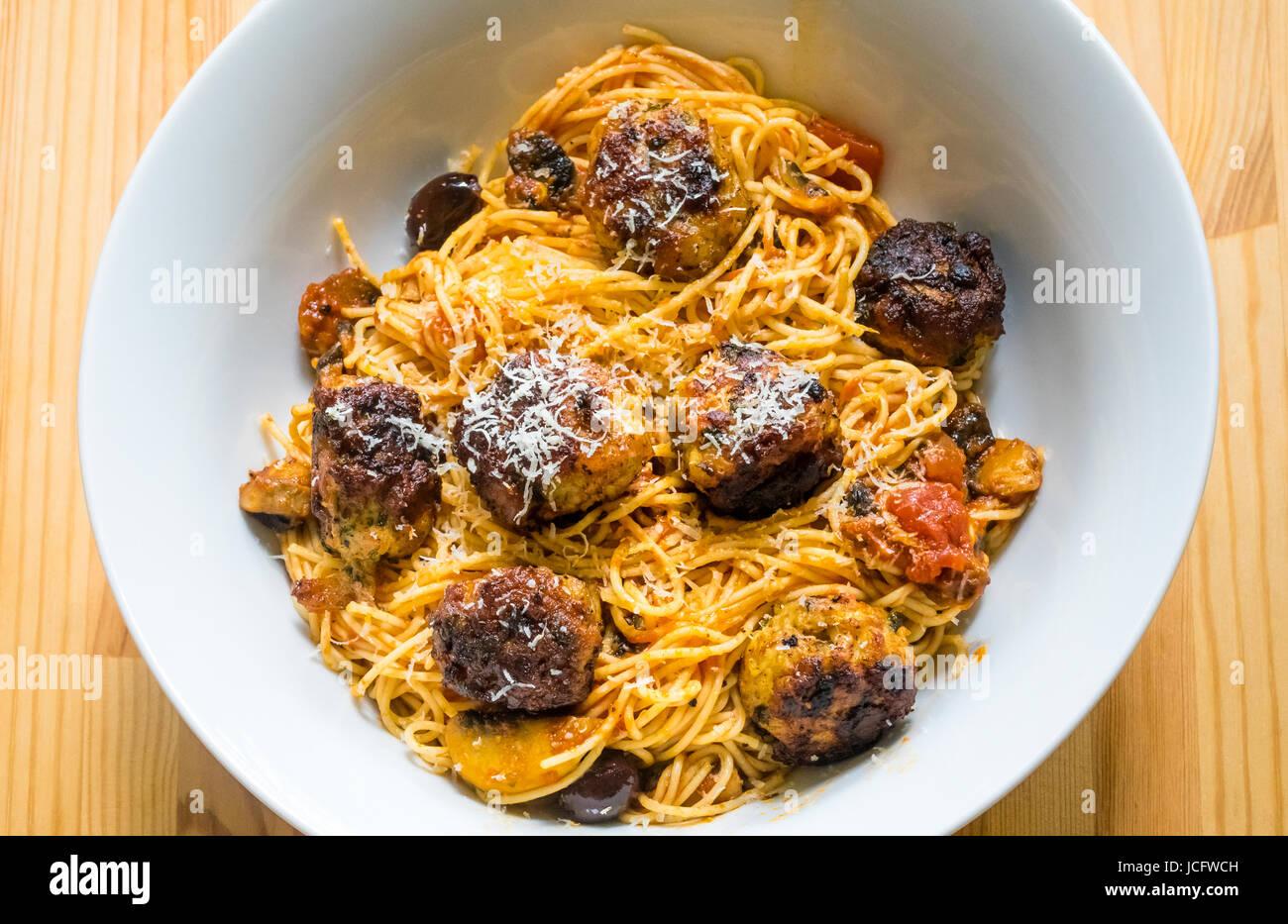 Spaghetti and Italian meatballs in a white bowl - Stock Image