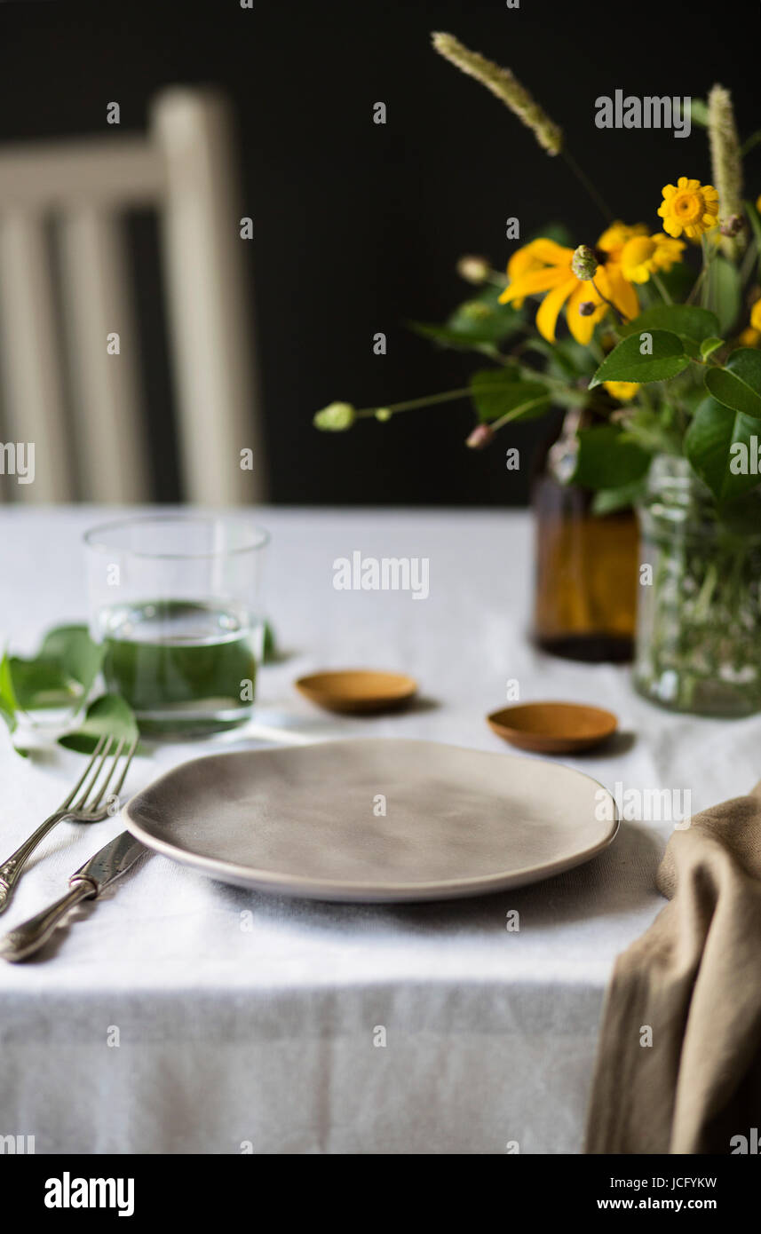 Table set with flower and props - Stock Image