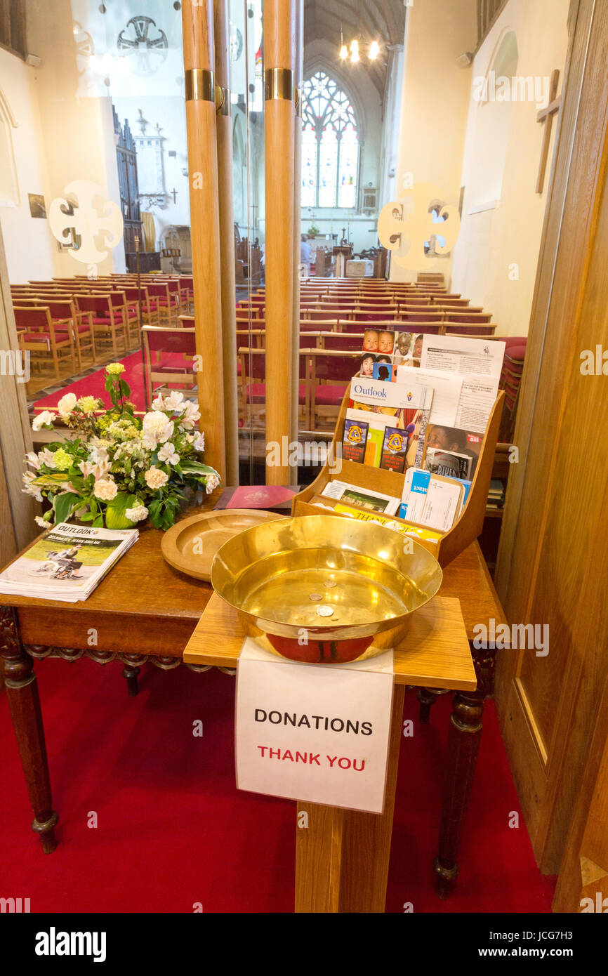 Donation tray in a village church, UK - St Mary's Church, Chartham, Kent UK - Stock Image