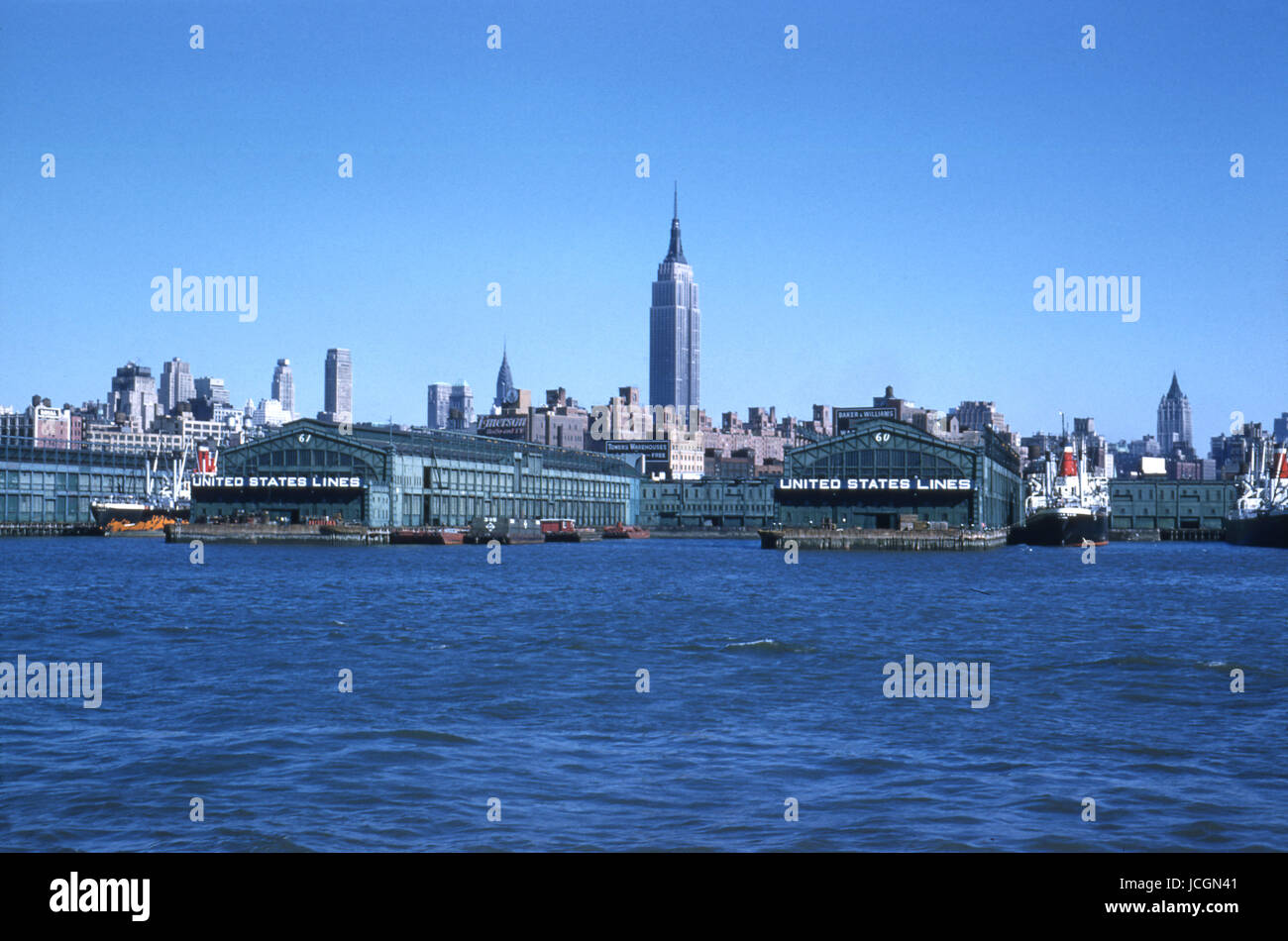 Antique October 1958 photograph, view of Pier 60 and 61 from the Hudson River in New York City, with the Empire - Stock Image