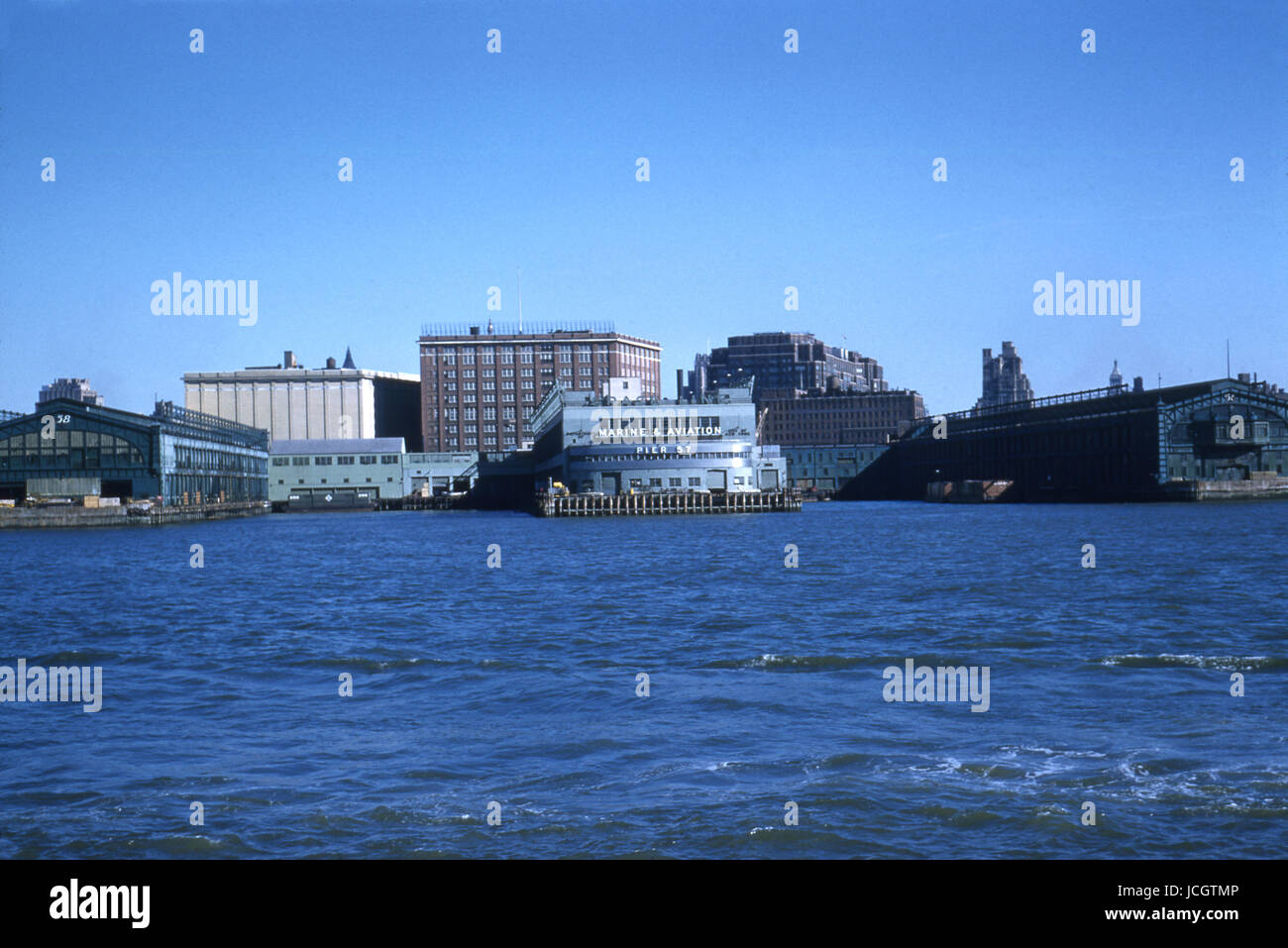 Antique October 1958 photograph, view of Pier 56, 57, and 58 from the Hudson River in New York City. SOURCE: ORIGINAL - Stock Image
