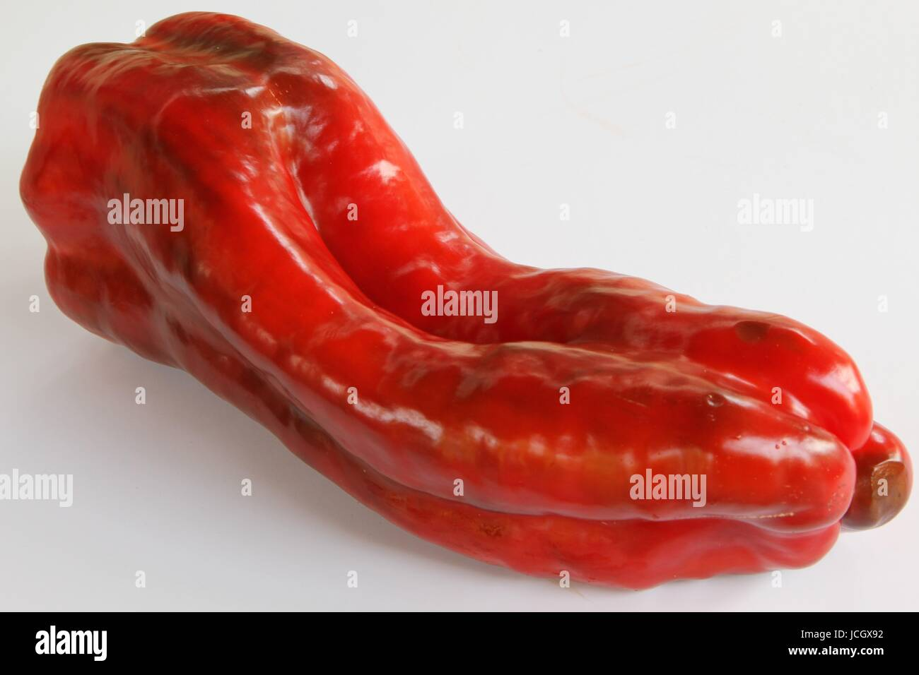 Red Pepper Close up on White background - Stock Image