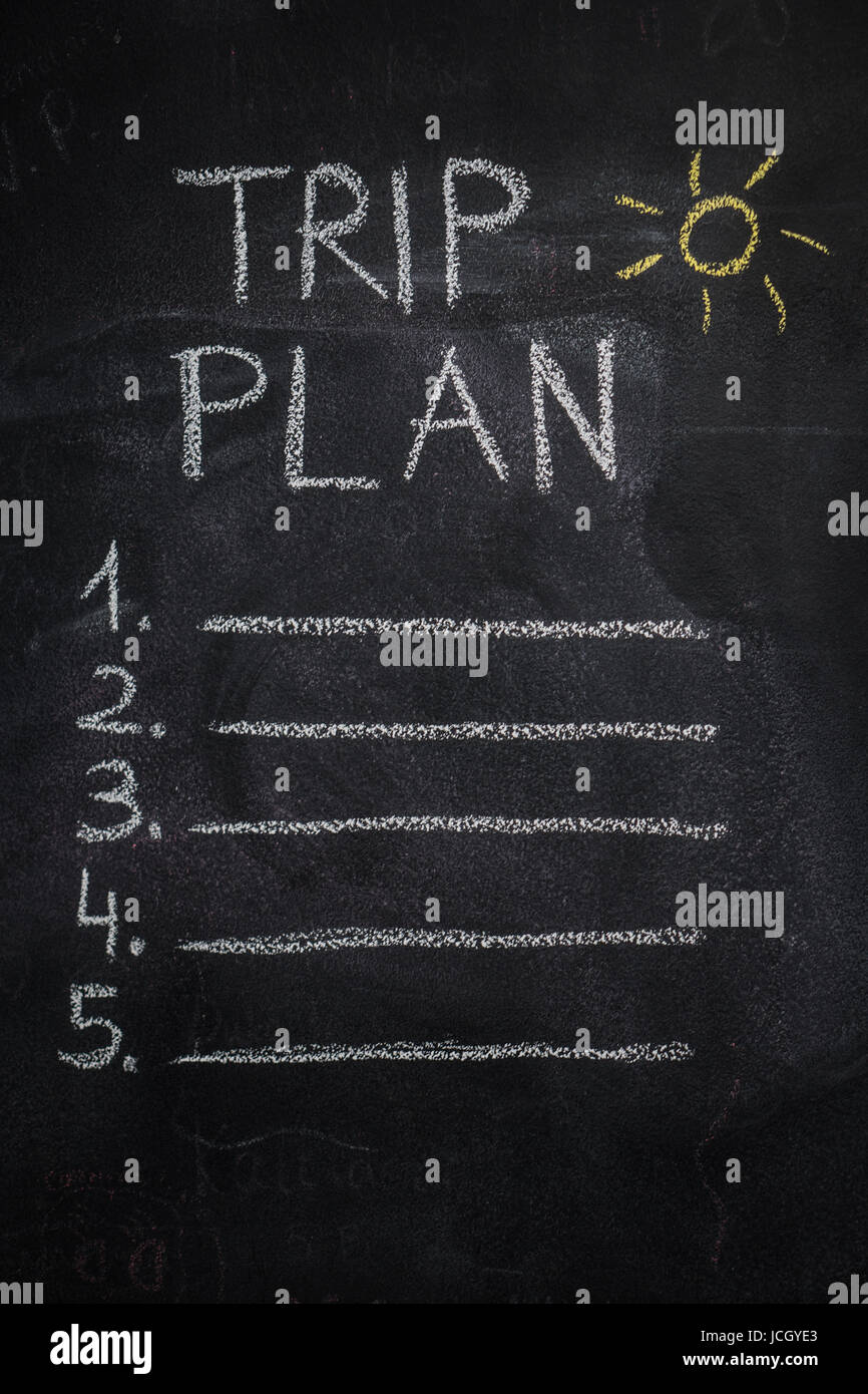Trip plan list written with white chalk and yellow sun drawing on blackboard. To do list, trip, vacation concept - Stock Image