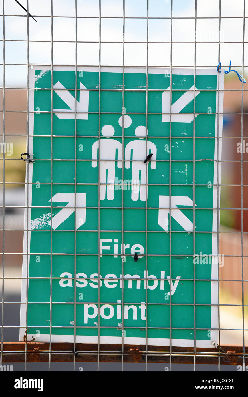 Fire assembly point building site warning information sign in Sutton Road, Southend on Sea, Essex. Sign board. Space - Stock Image