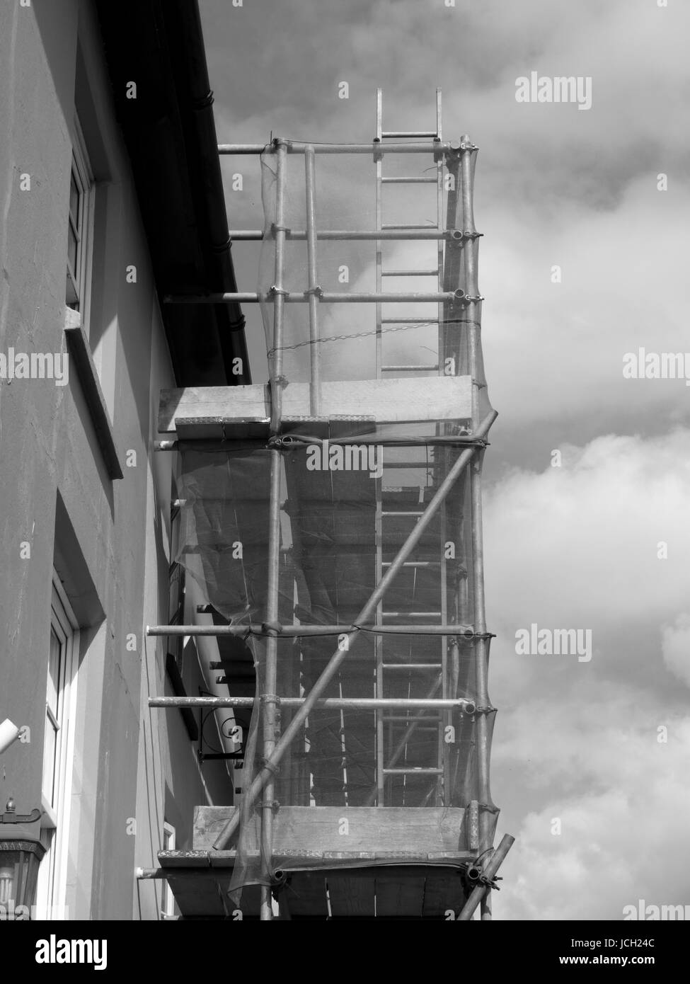 Scaffolding to residential building  undergoing renovation work - Stock Image