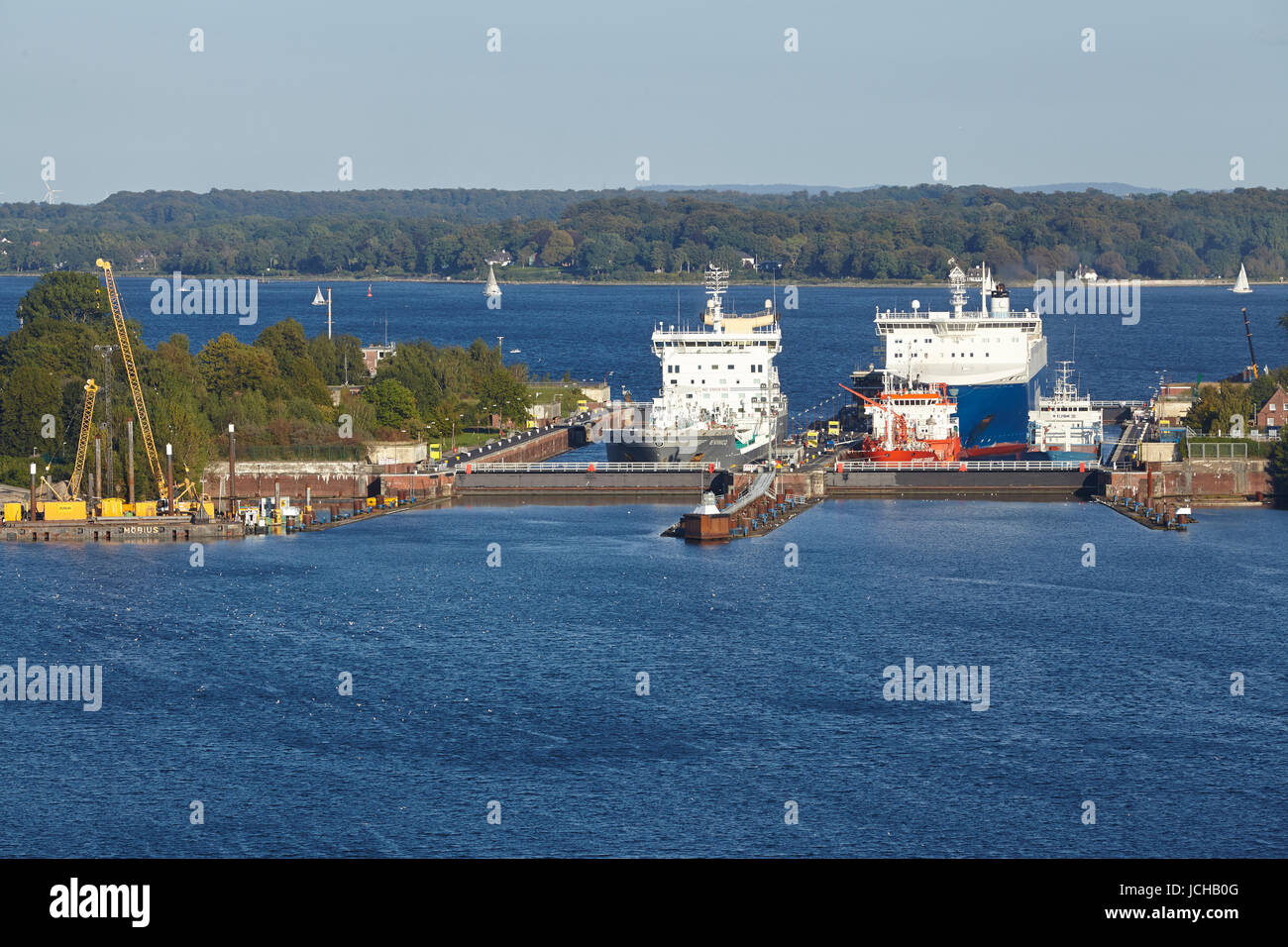 The tanker Evinco, genral cargo ship Wilson Hawk, tanker Eduard Essberger and Ro-ro cargo vessel Finnbreeze at the - Stock Image