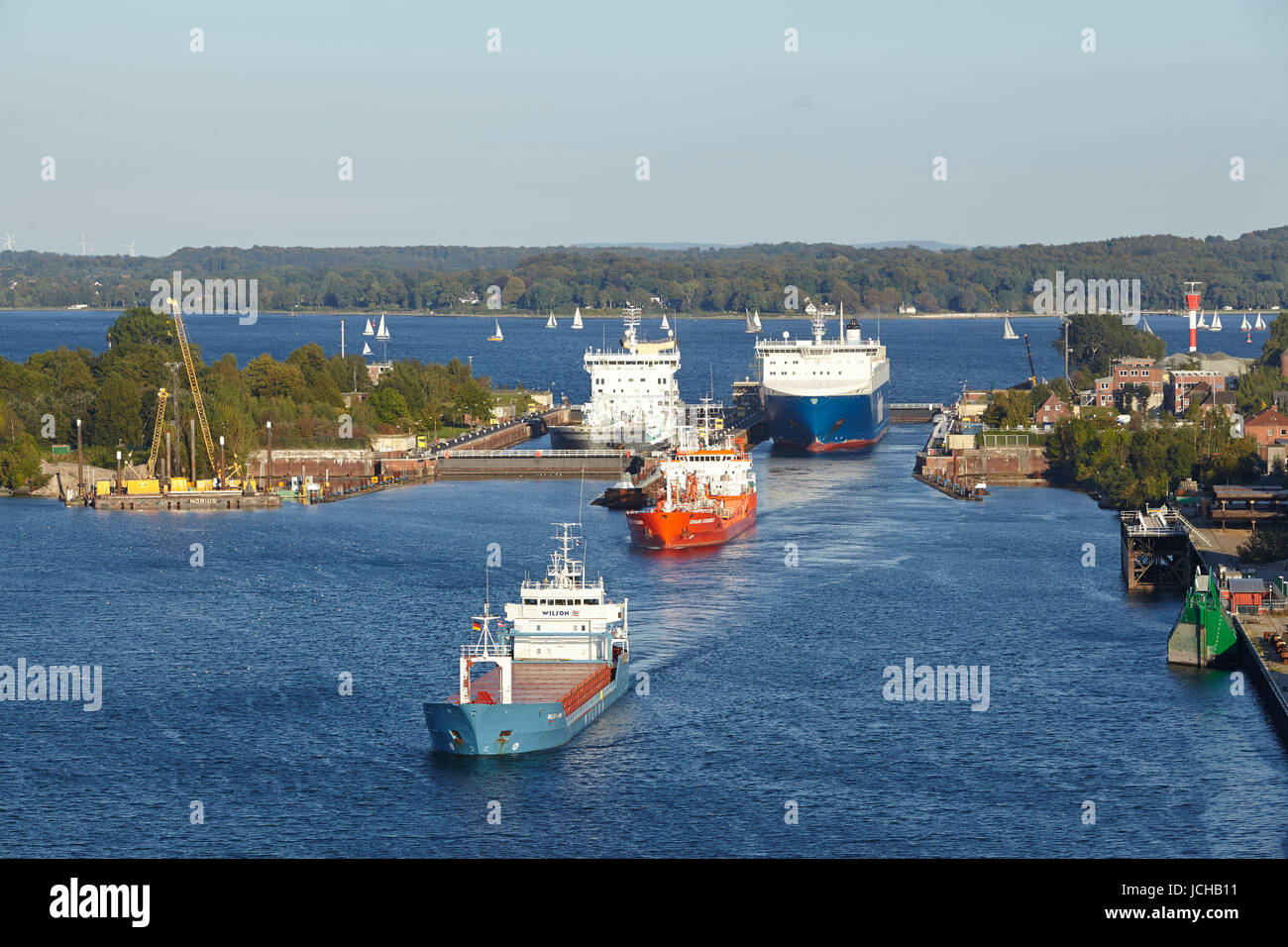 The genral cargo ship Wilson Hawk, tanker Eduard Essberger and Ro-ro cargo vessel Finnbreeze are leaving the lock - Stock Image