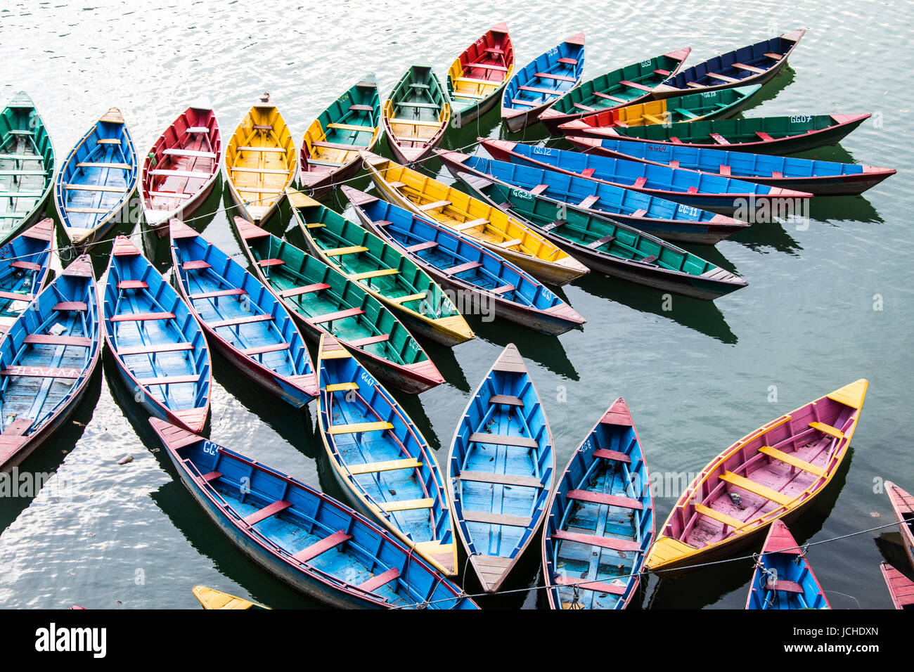 Colorful rowboats, Phewa Lake, Pokhara, Nepal - Stock Image