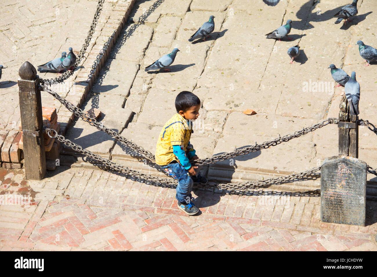 Local boy in Patan Durbar Square, Kathmandu, Nepal - Stock Image