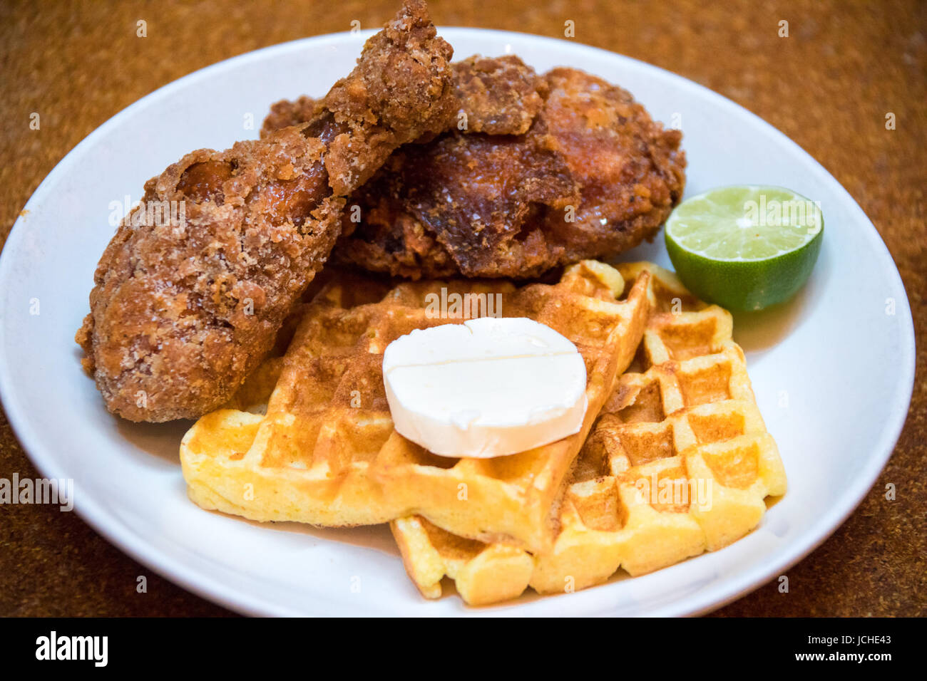 Habanero fried chicken and Waffles, Brunch at Momofuku Ma Peche Restaurant, Manhattan, New York - Stock Image
