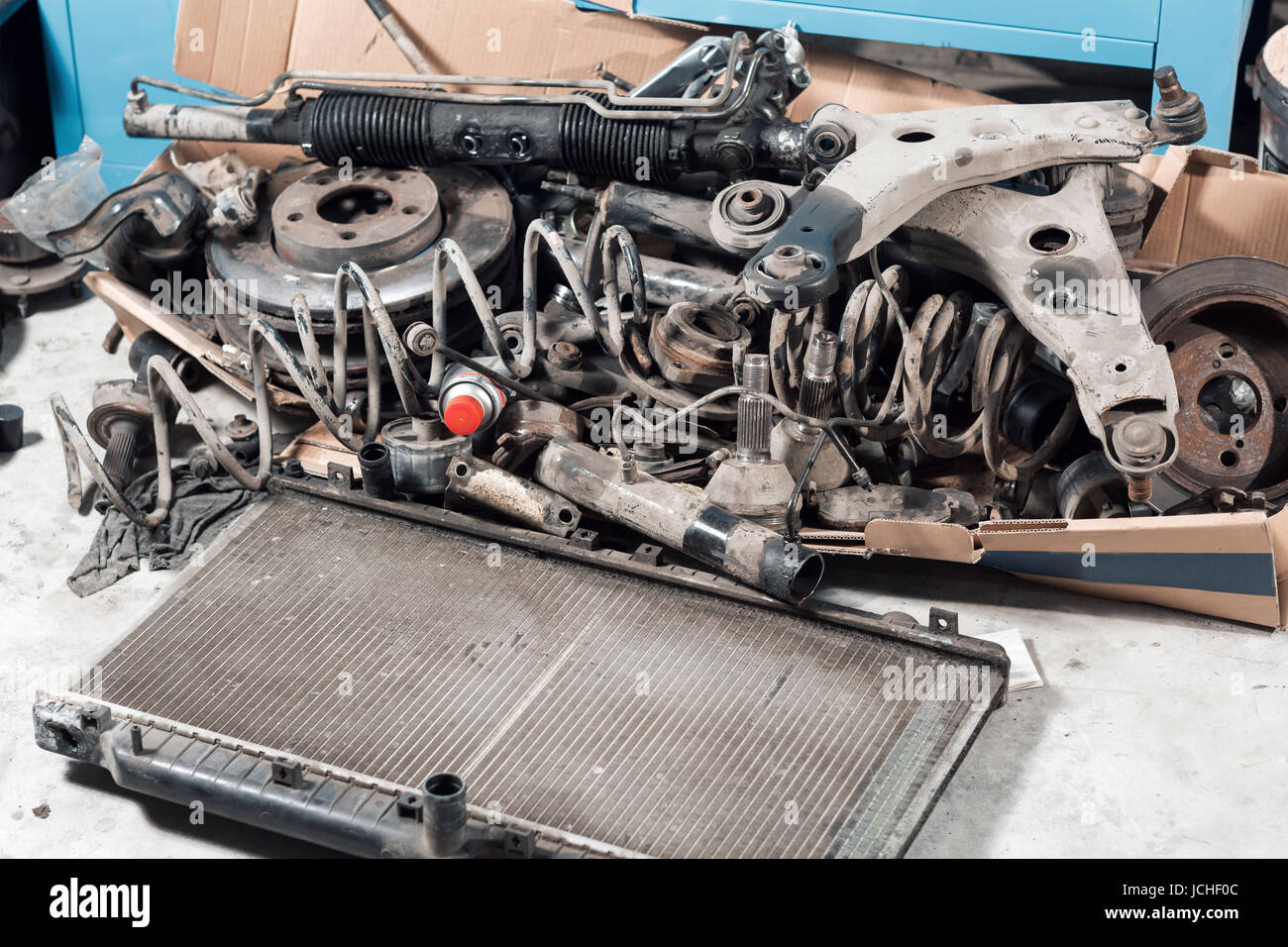 lot old car spare parts in service garage Stock Photo: 145443772 - Alamy