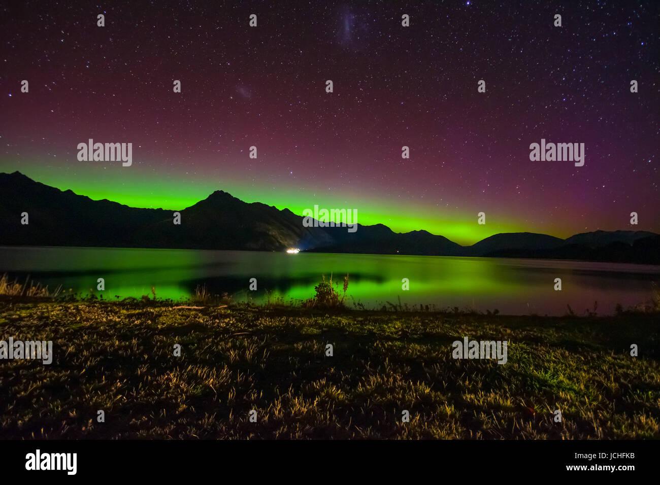 Aurora Australis and milky way over Lake Wakatipu, Kinloch, New Zealand South Island - Stock Image