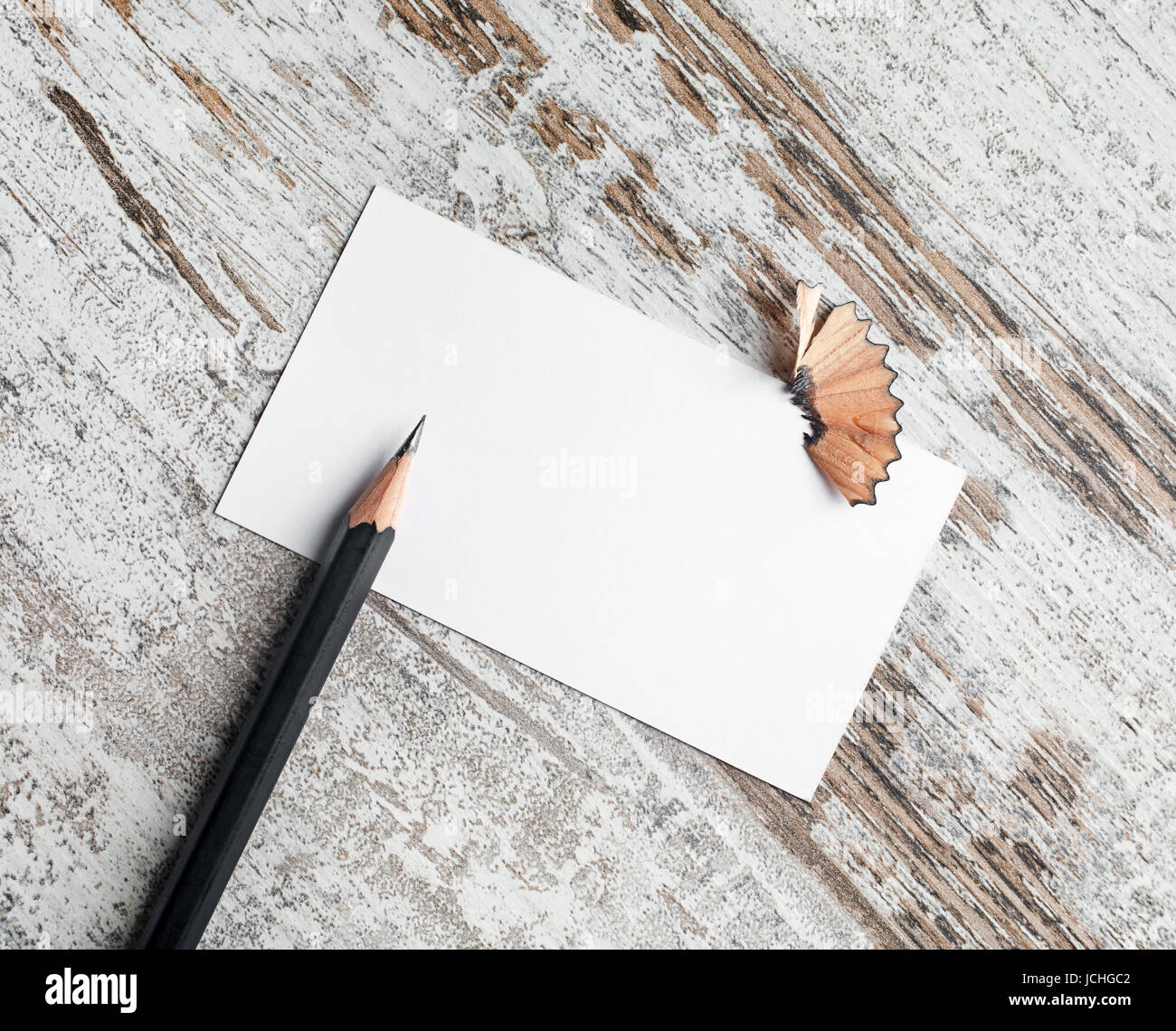 photo of blank business card and pencil on vintage wood table stock