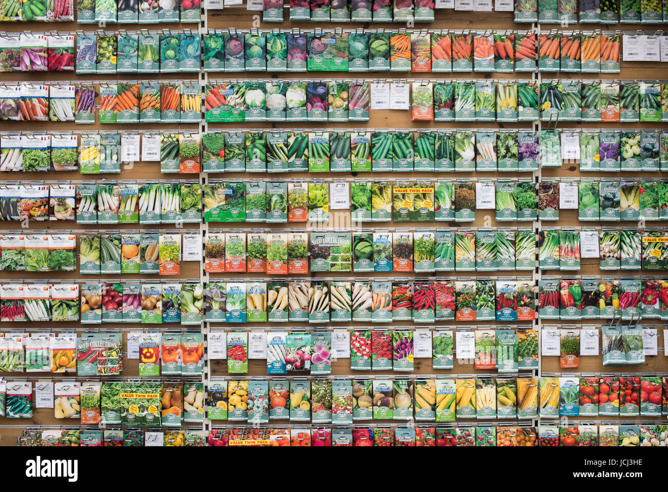 Vegetable seed packets on display in a garden centre. UK - Stock Image