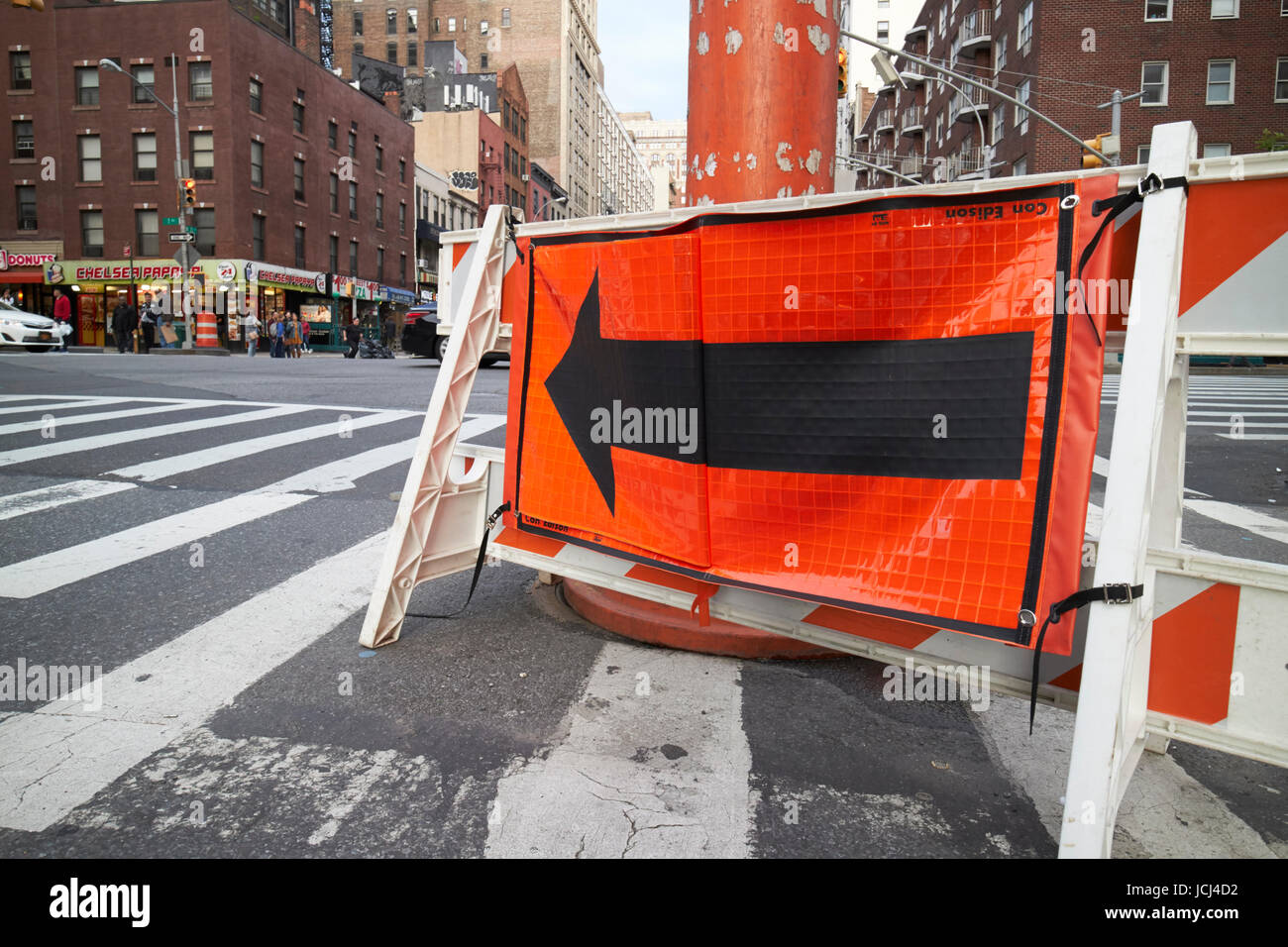 temporary diversion sign around steam vent pipe in street New York City USA - Stock Image