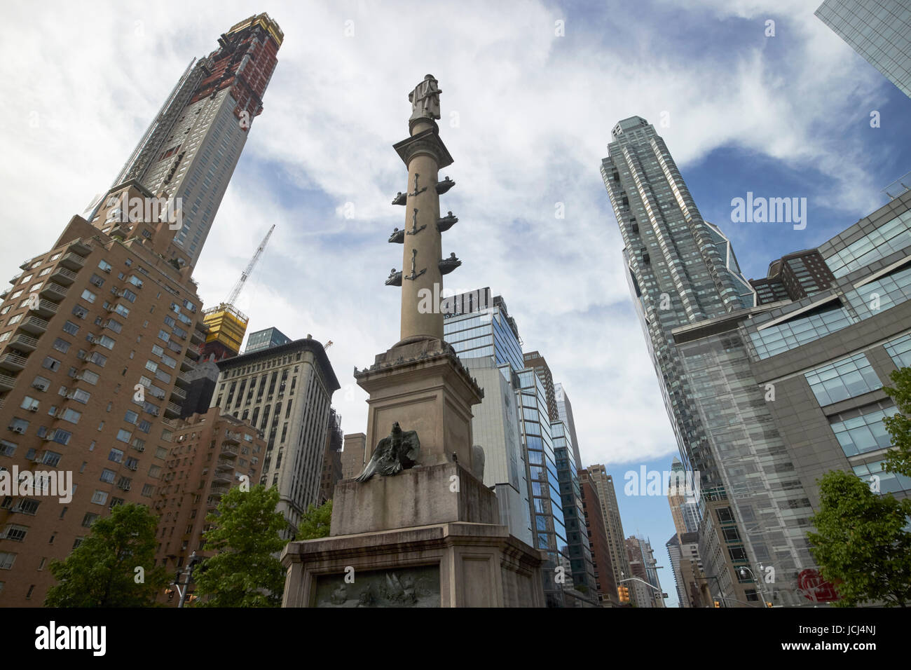 statue of christopher columbus in columbus circle with expensive luxury south central park apartment buildings New Stock Photo