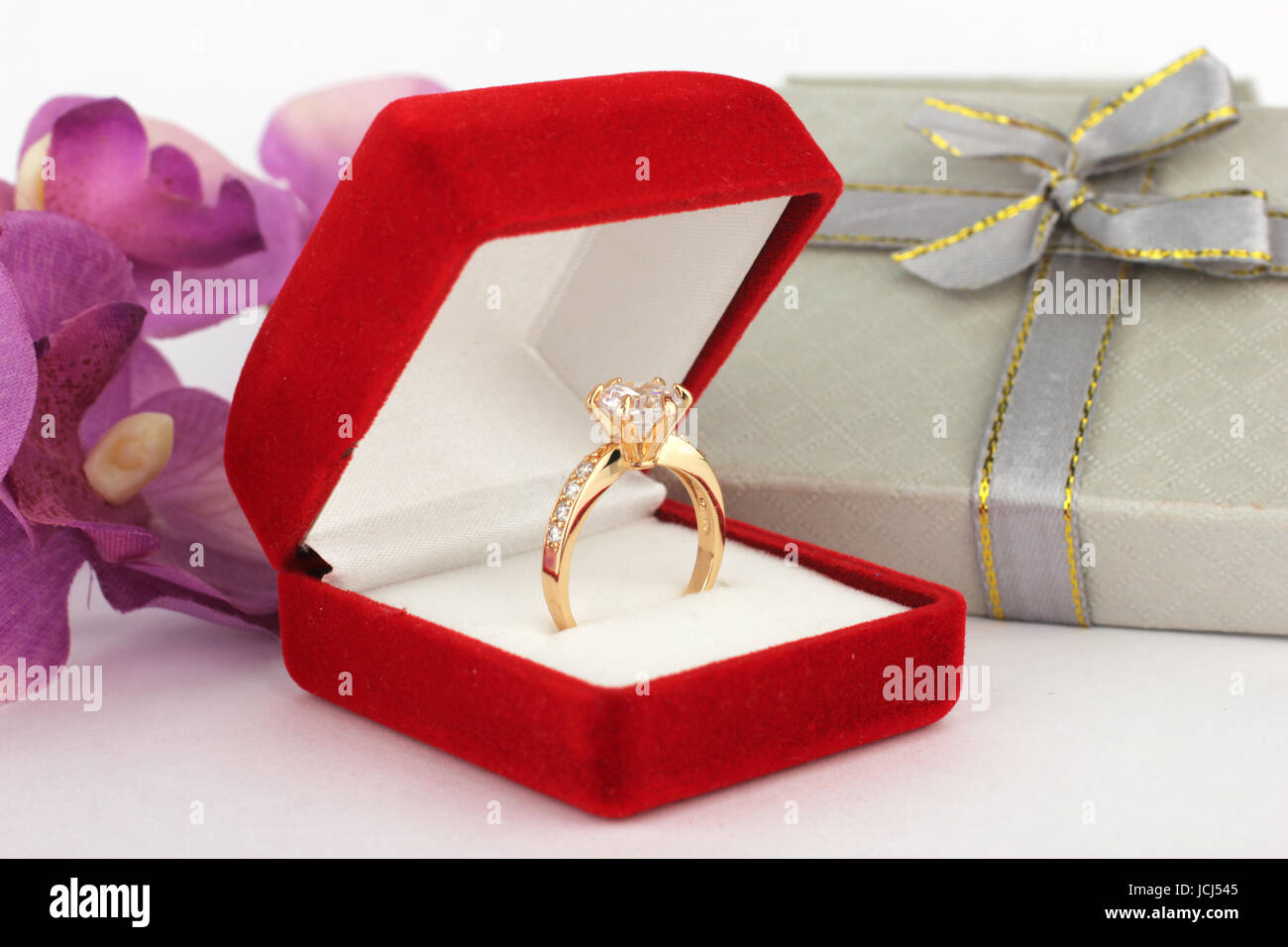 ring in jewelry box , flower background - Stock Image