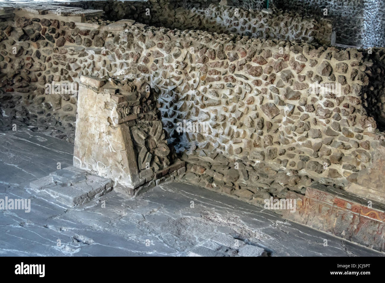 Four Petal Flower decoration carved in Stone Pillar of Aztec Temple (Templo Mayor) at ruins of Tenochtitlan - Mexico Stock Photo