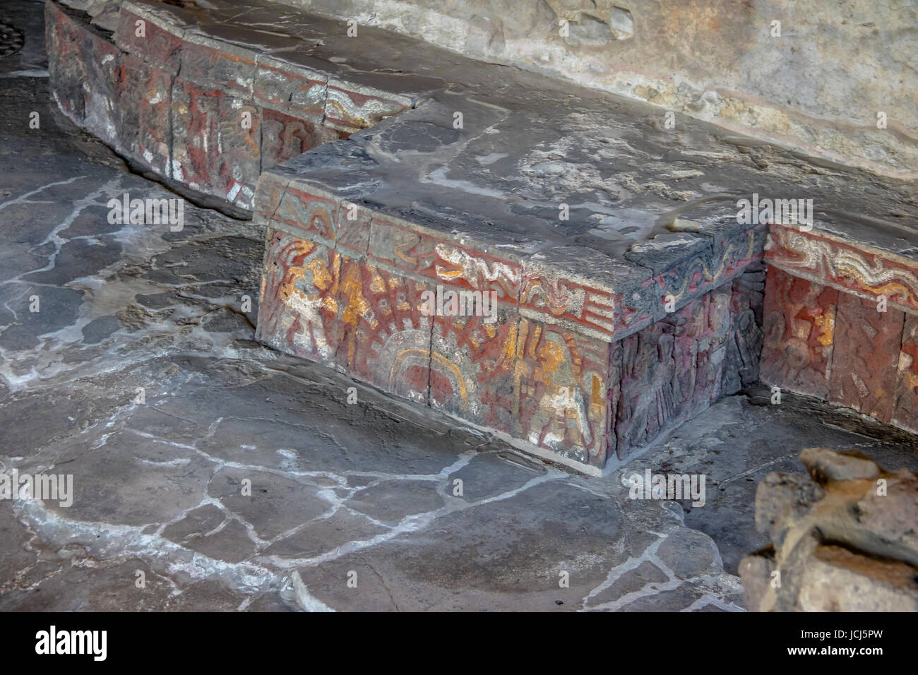 Colorful bas relief carving in stone benches of aztec temple templo