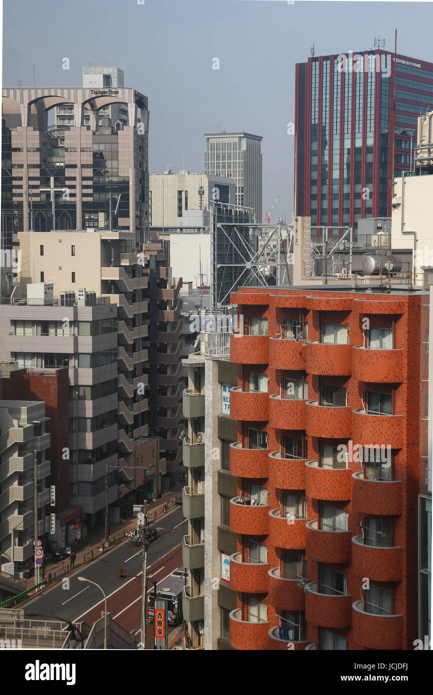 Tenth floor view of the street and urban area near Tamachi Station in Tokyo, Japan, where there are many apartment Stock Photo