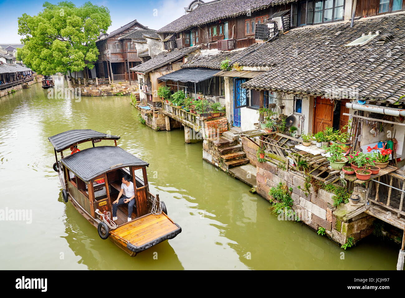 Traditional wooden chinese boat on the Wuzhen canal, Zhejiang province, China Stock Photo
