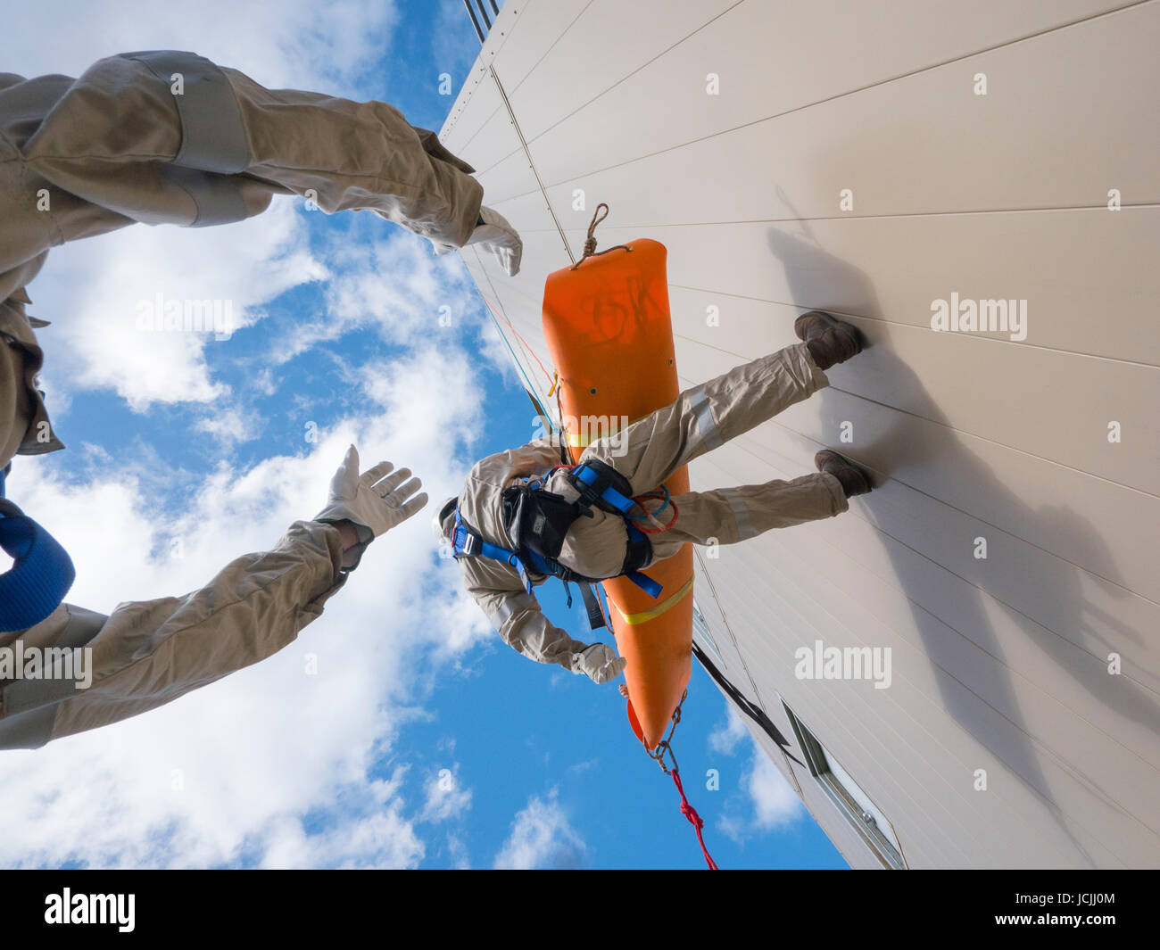Crews practice high angle rescue at a public training facility at an industrial site in Oregon using ropes, litters - Stock Image