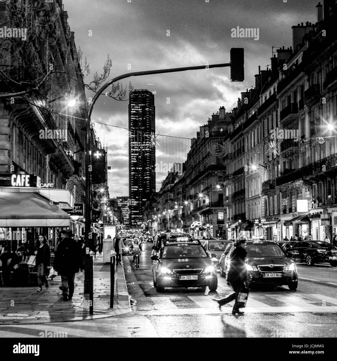 PARIS- FRANCE -  RUE DE RENNES AND MONTPARNASSE TOWER AT LATE AFTERNOON - PARIS STREET - PARIS STREET PHOTOGRAPHY - Stock Image