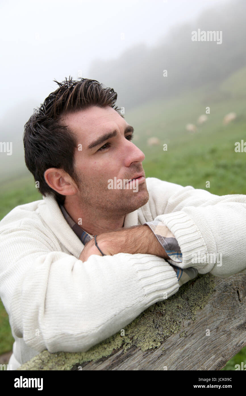 Portrait of breeder leaning on fence Stock Photo