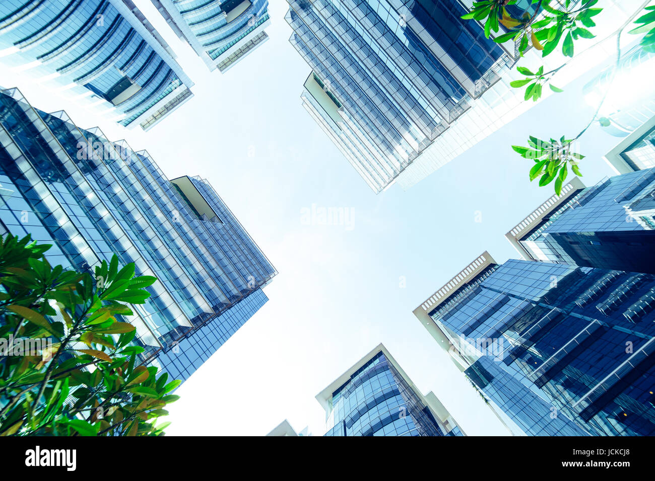 Common modern business skyscrapers, high-rise buildings, architecture raising to the sky, sun. Concepts of financial, - Stock Image