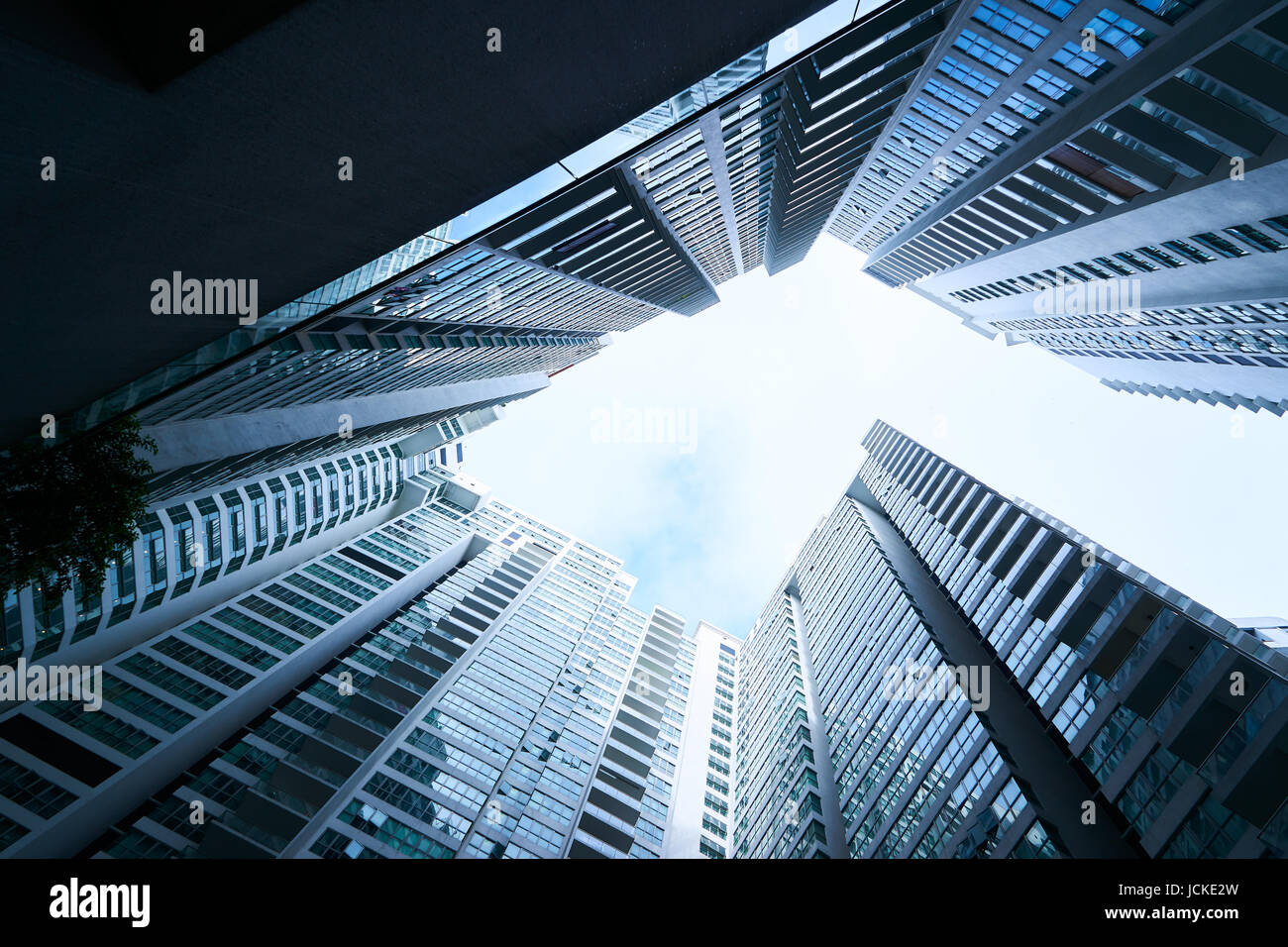 Abstract low angle view of common modern business skyscrapers.Multistoried modern and stylish living block of flats. - Stock Image