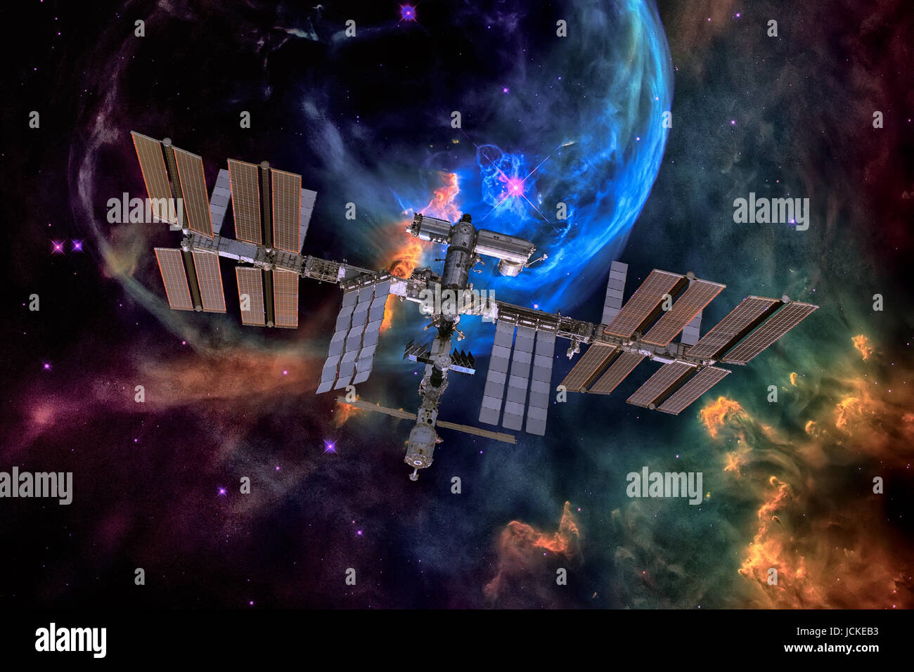 International Space Station over nebula. Elements of this image furnished by NASA. - Stock Image