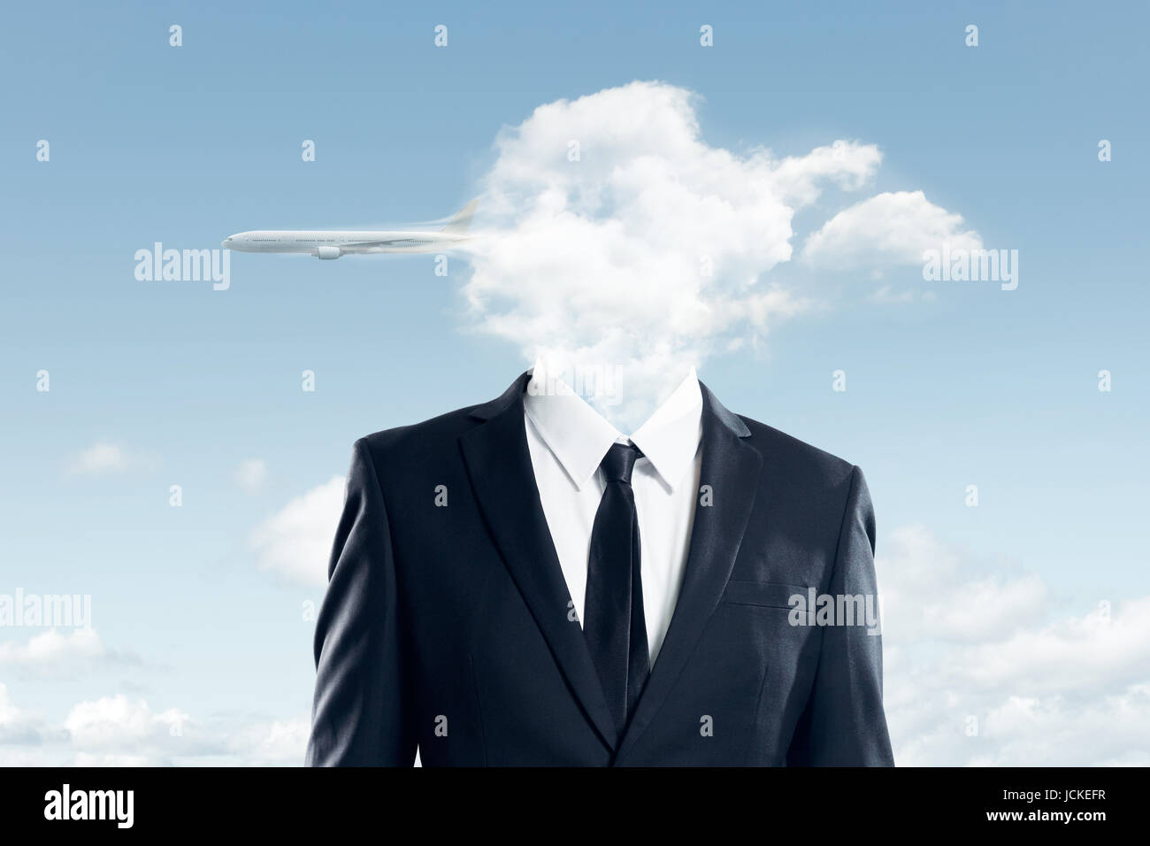 The head of the businessman is covered with clouds , and the plane flew over the clouds ,business concept . - Stock Image