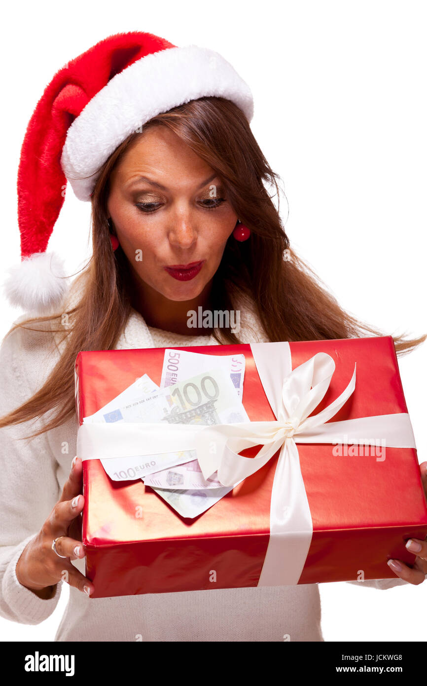 Schöne junge Frau mit Nikolausmütze mit einem großen roten Stock ...