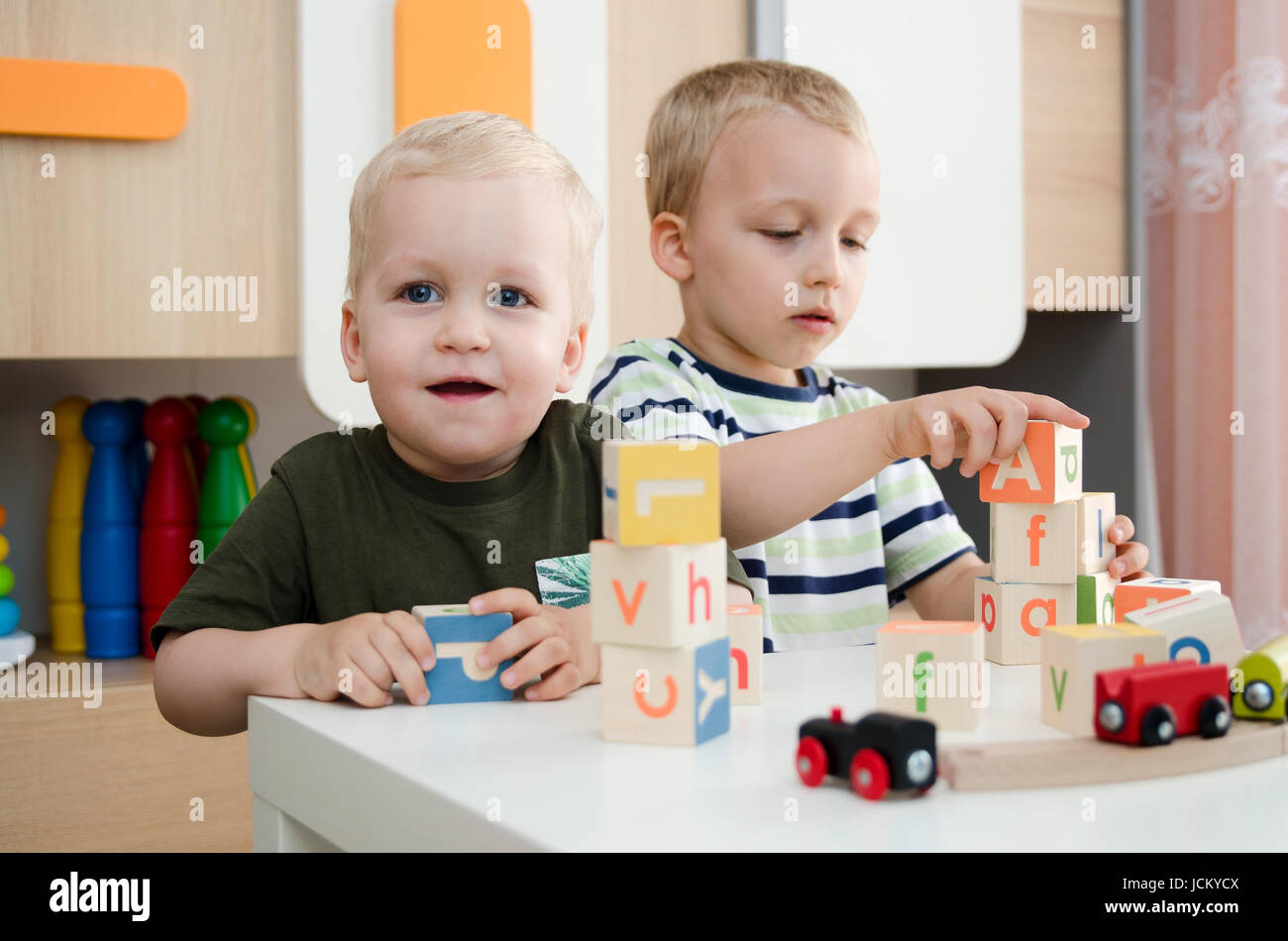 Kids Boys Playing With Toy Blocks At Home Or Kindergarten Children