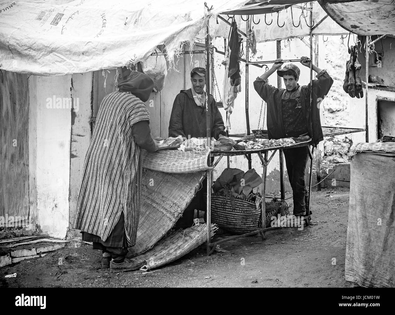 Butcher stand in a traditional countryside market in Morocco - Stock Image