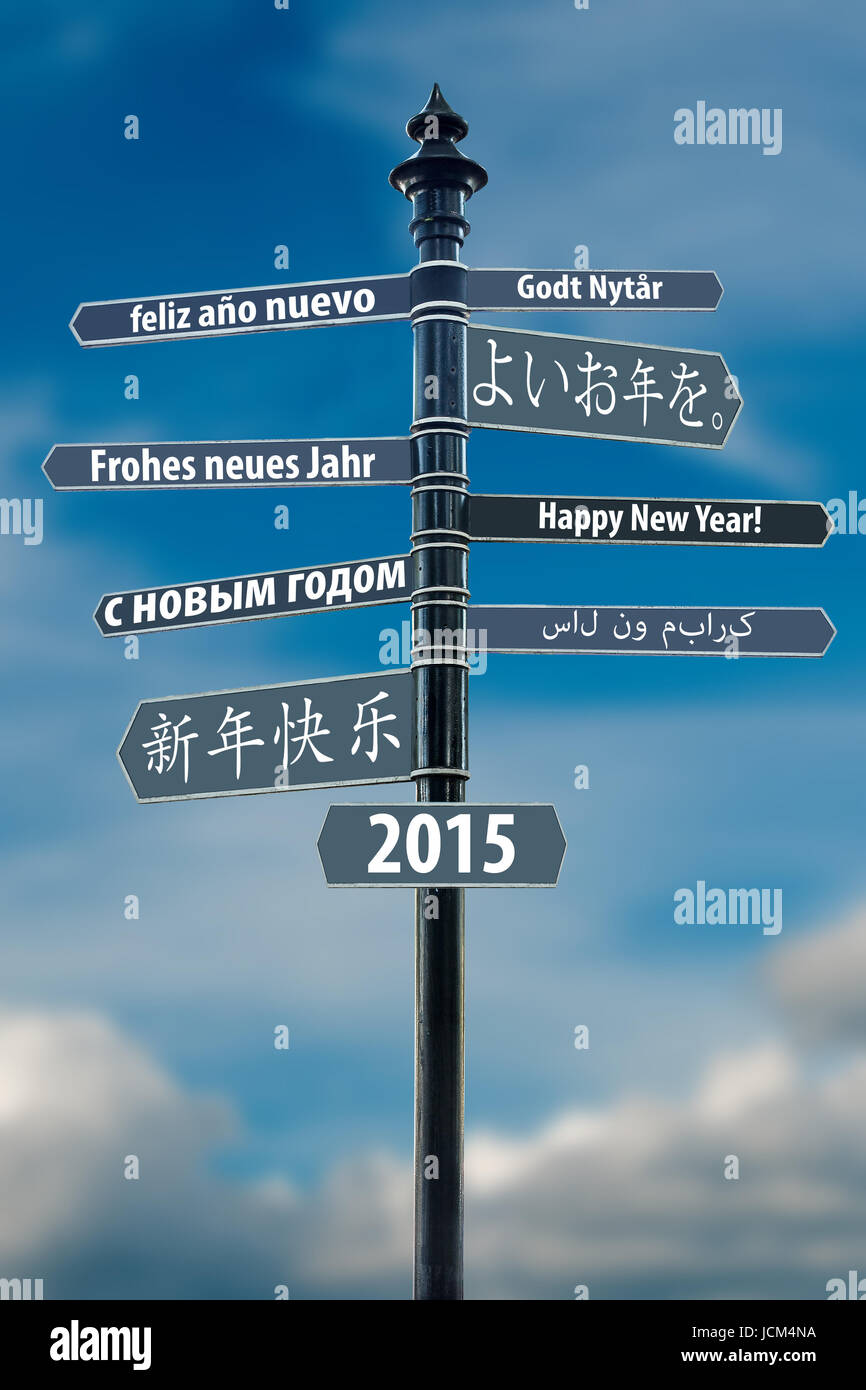 Signpost whit Happy New Year in many languages - Stock Image
