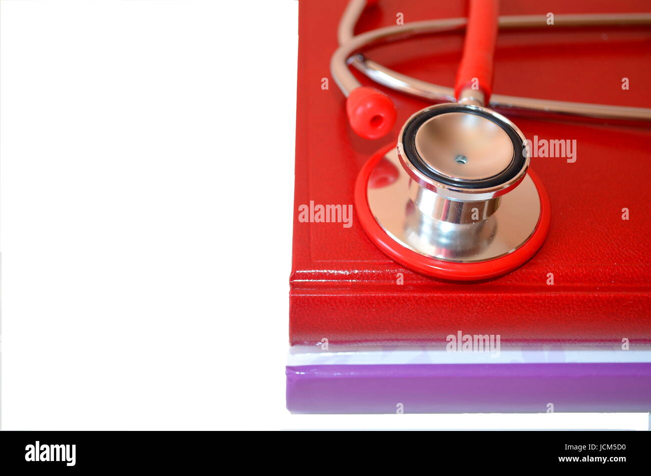 Medical student life: books and stethoscope - Stock Image