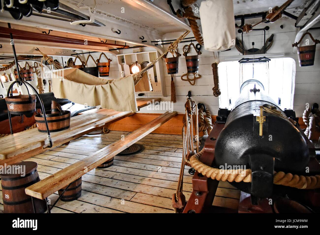 Portsmouth England UK HMS Warrior a 40-gun steam-powered armoured frigate built for the Royal Navy.The gun deck, - Stock Image