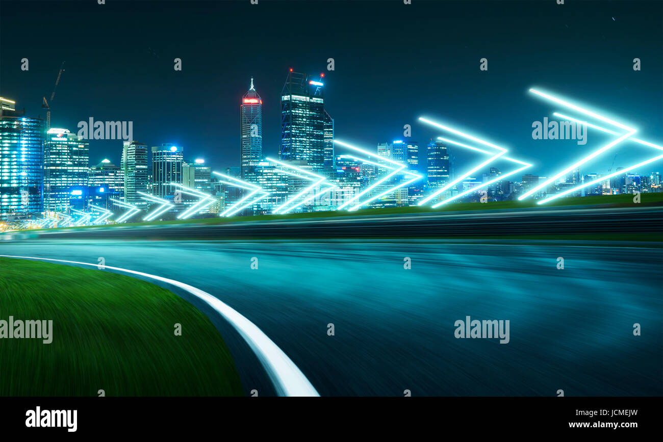 Motion blurred racetrack with city skyline background ,night scene cold mood. with arrow light Effects. - Stock Image