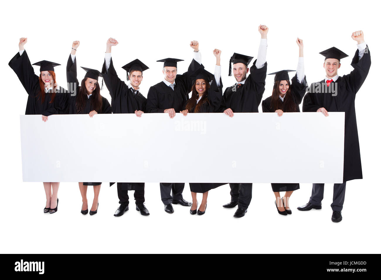 cheerful excited graduate students showing empty banner isolated on