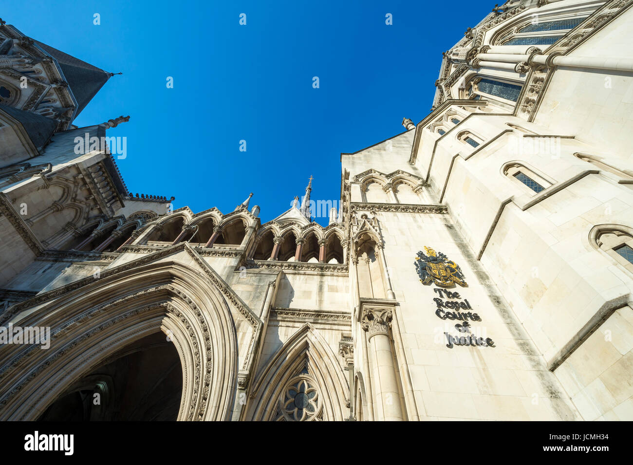 The Victorian Gothic style main entrance to the The Royal Courts of Justice public building in London, UK, opened - Stock Image