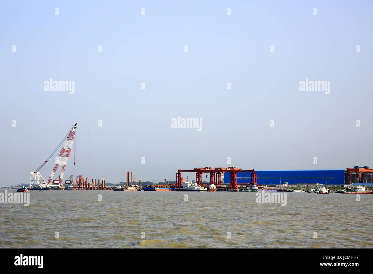 Bridge construction work in progress on the Padma River. Bangladesh - Stock Image