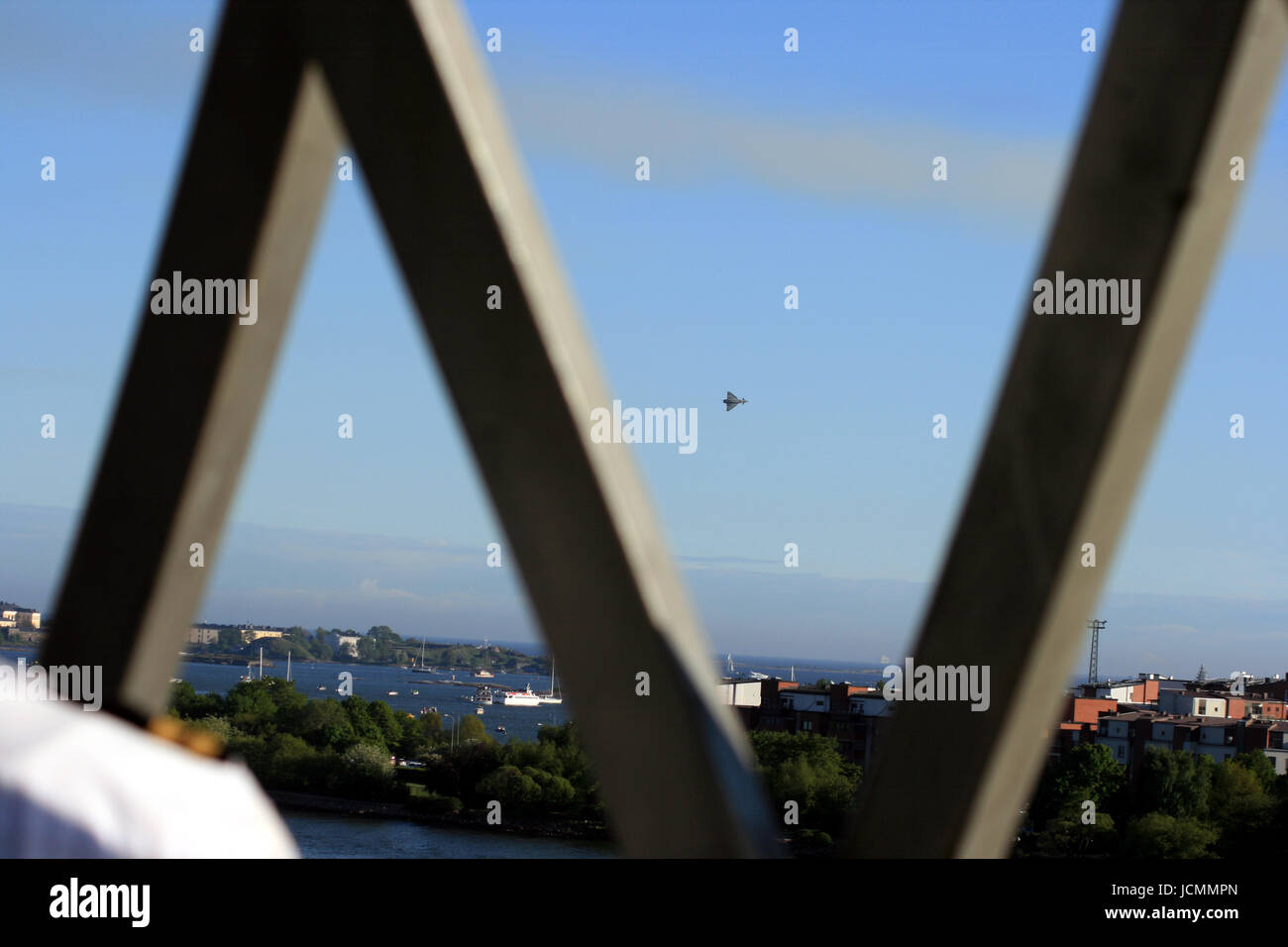 jet over helsinki with pilot in foreground Stock Photo